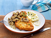Escalope chasseur (pork escalope with mushroom sauce) with mashed celeriac