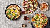 Three pizza ideas with grapes and salmon, spinach and eggs metballs and pomegranate