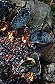Charcoal bread being grilled