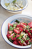 Watermelon and raspberry salad with feta cheese and pistachios