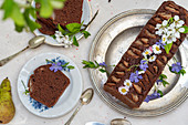 Chocolate pie with pears and flowers