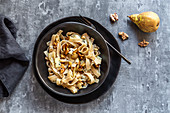 Spelt tagliatelle with balsamic pears, gorgonzola, walnuts and cashew nuts