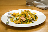 Salmon kedgeree on plate with fork (England)