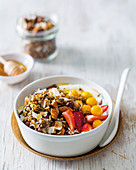 Cocoa-nib granola with coconut flakes and fruits