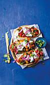 Vegetarian masala naan pizzas