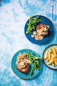 Pork neck steaks with miso mushroom sauce and chips