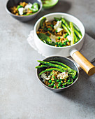 Green goddess barley risotto with asparagus and peas