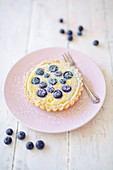 Almond cream cake with blueberries