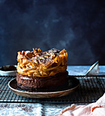 Chocolate and coffee mousse cake topped with cocoa filo pastry