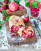 Apple and cranberry strudel with yeast dough and almond flakes