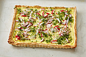Herb tart with a radish topping