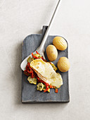 Artichoke and pepper raclette with taleggio