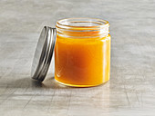 A jar of pumpkin preserve with apple