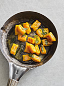 Pumpkin gnocchi with sage butter in a pan
