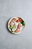 Rice paper rolls with fruit and mint