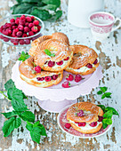 Choux pastry rings with quark cream and raspberries