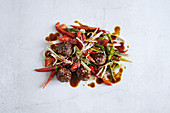 Stir-fried chicken meatballs with sesame seeds