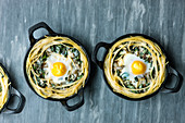 Oven-baked pasta nests with chard and fried eggs
