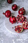 Pomegranate fruits whole and sliced ​​with ripe grains