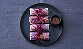 Vegan summer rolls with red cabbage and a spicy chilli dip