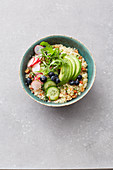 Vegan quinoa avocado bowl with blueberries