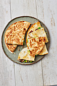 Mexican avocado quesadillas with minced beef and mushrooms