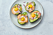 Oven-baked avocado with salmon and eggs