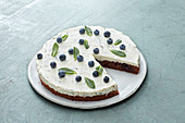 Chocolate and blueberry oil-sponge cake with mint cream