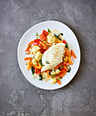 Cod with pan-fried vegetables made in a hot-air fryer