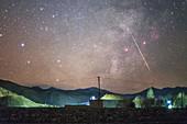Meteor over Tibetan village