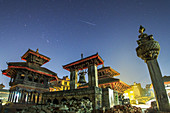 Geminid meteor above Kathmandu monuments