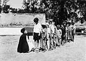 Children being weighed at tuberculosis camp, 1920