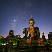 Night sky over Buddha statue, Thailand