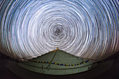 Star trails over Buddhist stupa