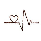 Coffee beans making an electrocardiogram line and heart shap