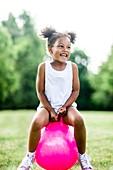 Girl bouncing on inflatable hopper