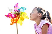 Girl blowing paper windmill