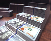 Stacks of one hundred US dollar banknotes, illustration