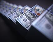 Stacks of one hundred US dollar banknotes, illustration