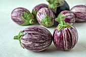 Stripped round aubergines