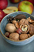 Walnuts and hazelnuts in a ceramic bowl