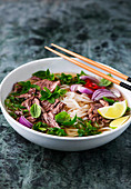 Pho bo (traditional beef soup with rice noodles, Vietnam)