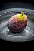 A purple fig in a bowl