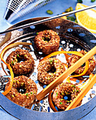 Steamed date rings with pistachio nuts and sesame seeds