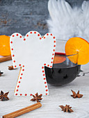 An angel fondant biscuit and a cup of mulled wine with persimmon