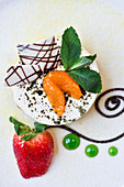 No bake Yuzu and Tofu Cheesecake nicely decorated with chocolate and fruit