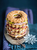 A wreath cake with mortadella, ham and vegetables