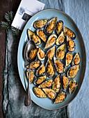 Cozze gratinate alla tarantina (gratinated mussels, Italy)