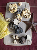 Various truffles on a grey board