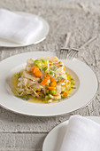 Stockfish in white wine with vegetables, fennel leaves and sage